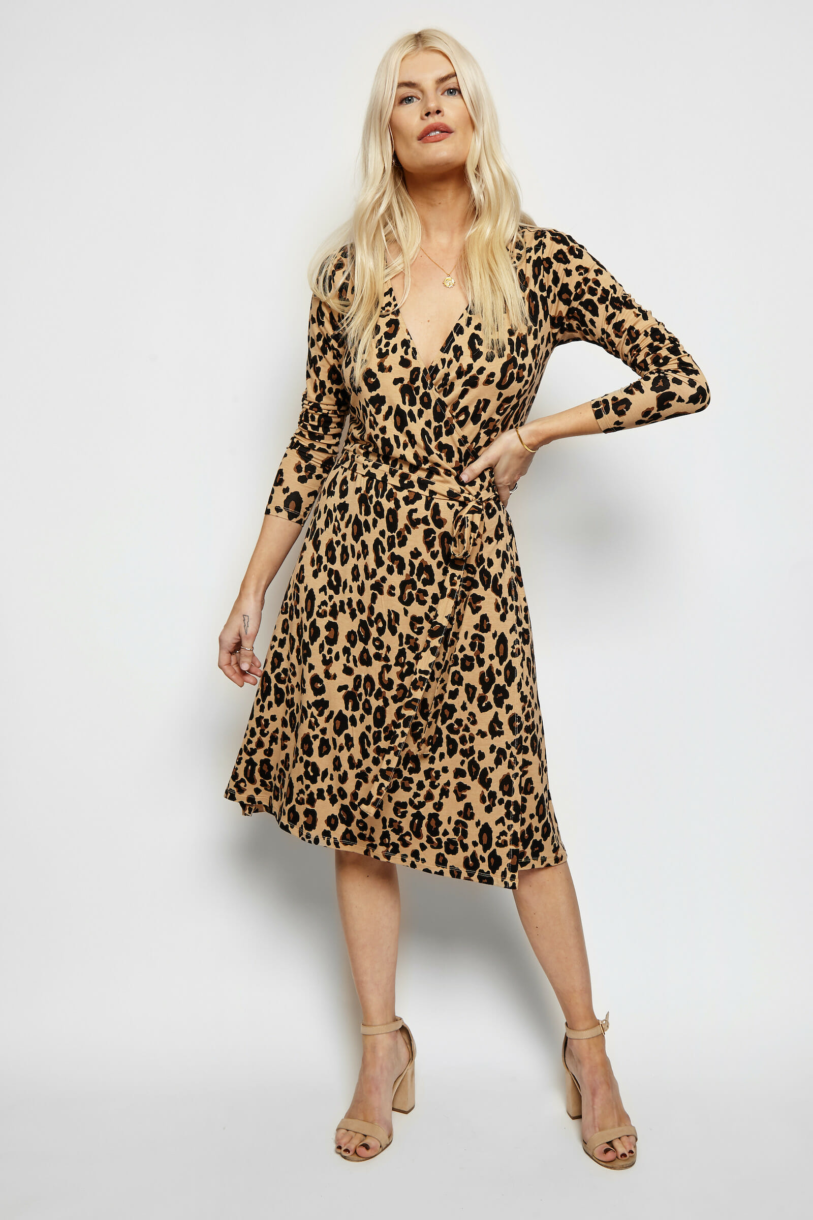 Lady wearing an animal print toffee and taupe wrap dress